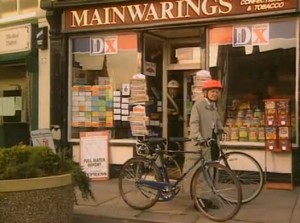 Opening scene of Rag Week with the shop name Mainwaring's briefly visible